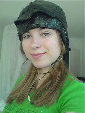 Alien abductee wearing thought screen helmet.